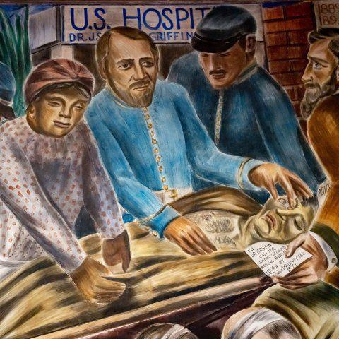 Mural showing a Black physician and others tending to the wounded