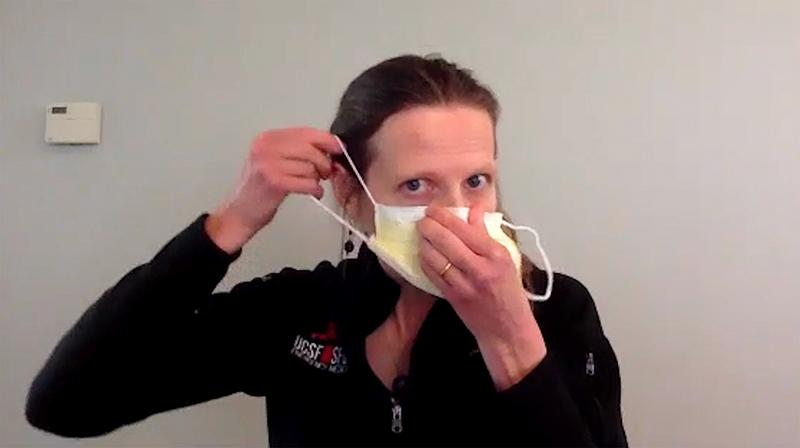 woman showing how to put on a mask
