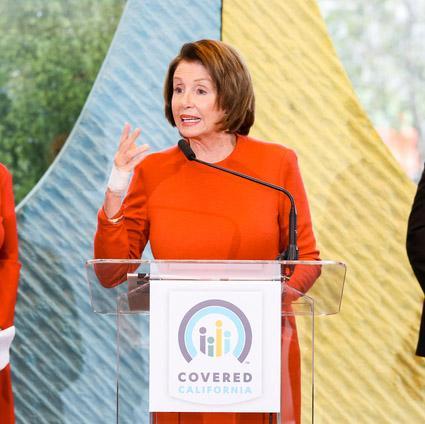 Nancy Pelosi at a podium at UCSF