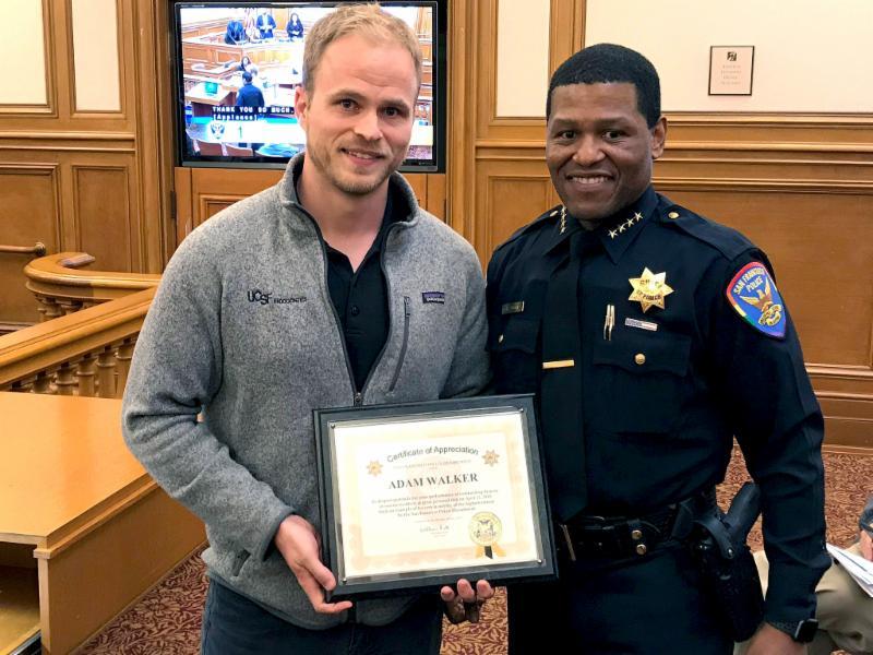 Adam Walker holding certificate