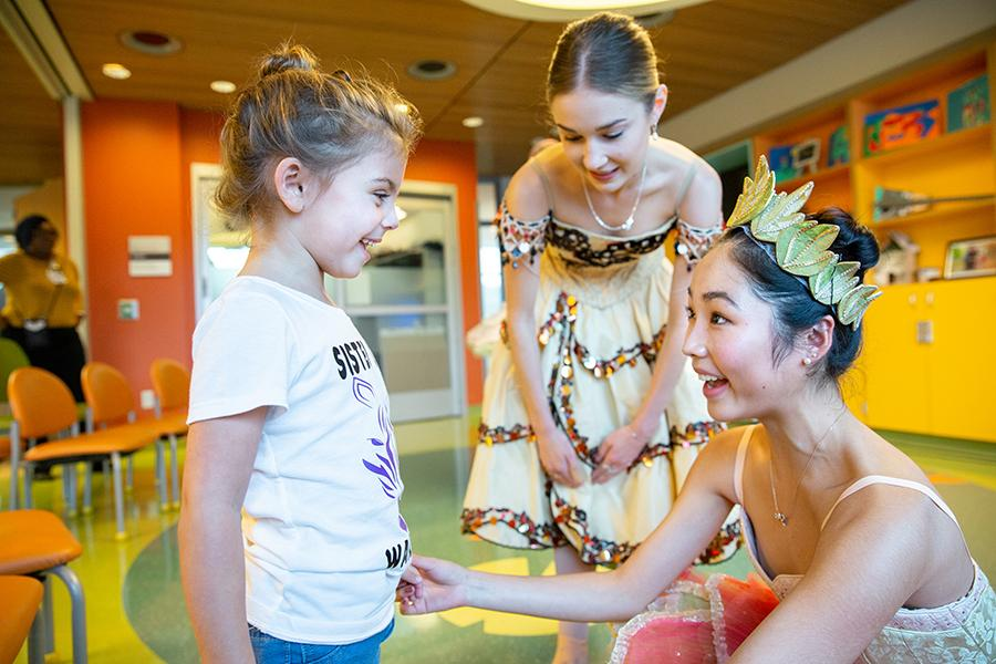 Nutcracker performers with a patient