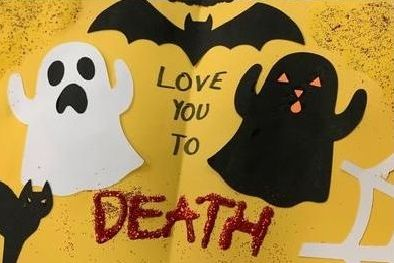 a card with ghosts and bats saying I love you to DEATH
