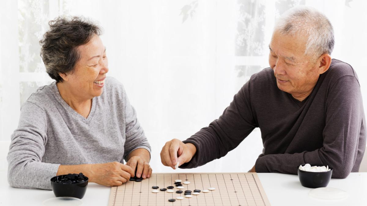 Two elderly people playing a game