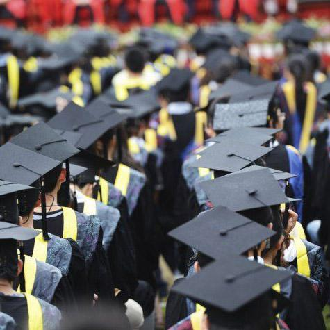 Rows of students in graduation caps