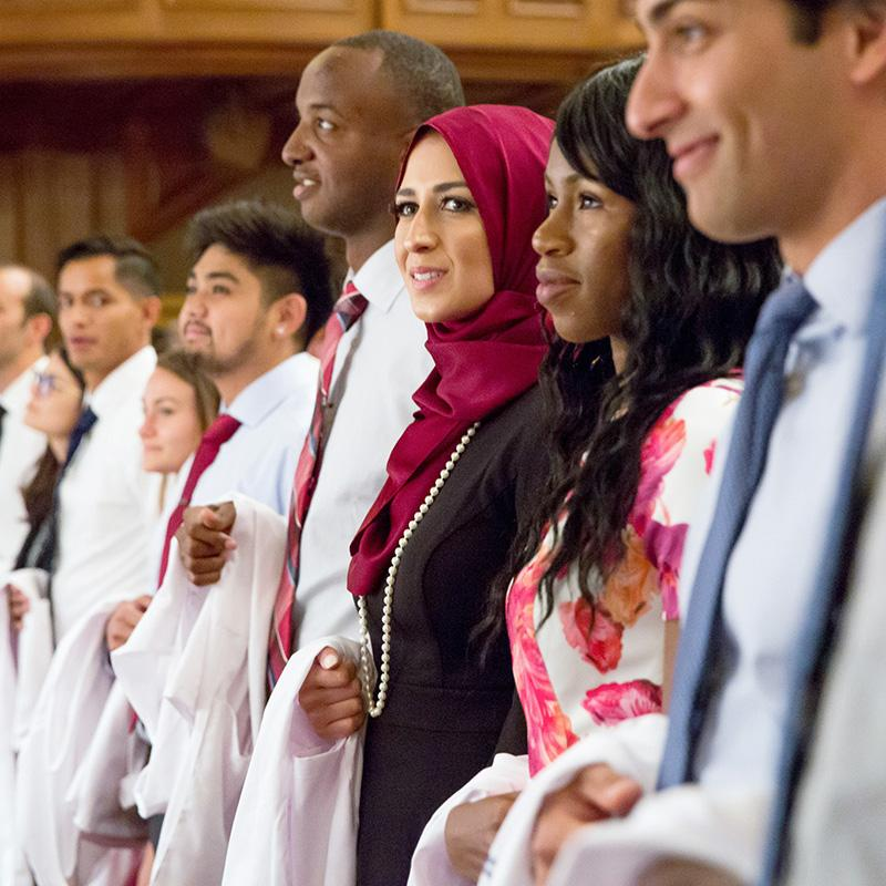 Students in a white coat ceremony in a row
