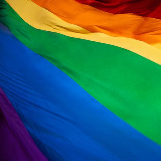 A rippling rainbow flag