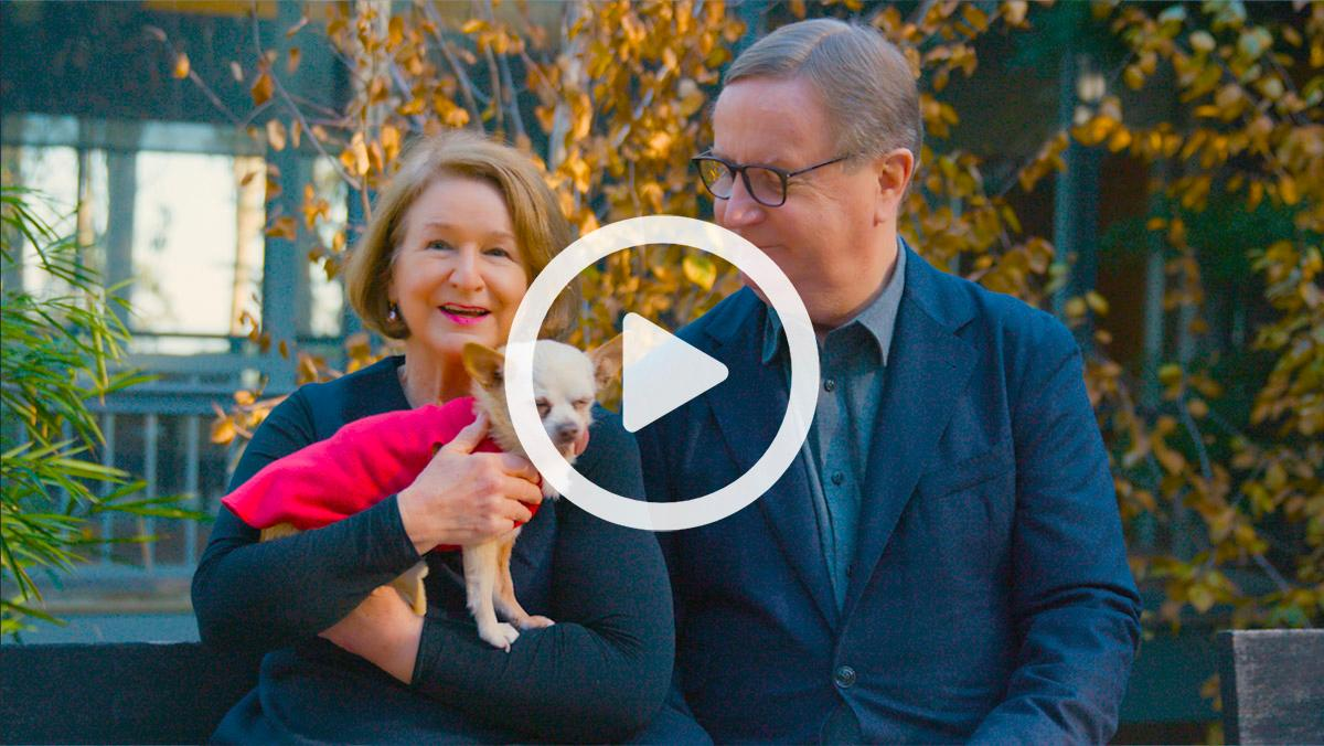 Jane Sam Hawgood and their chihuahua Henry against a fall backdrop