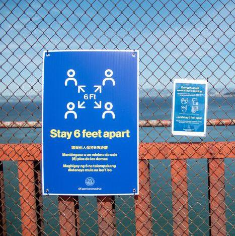 Sign saying stay six feet apart on the golden gate bridge