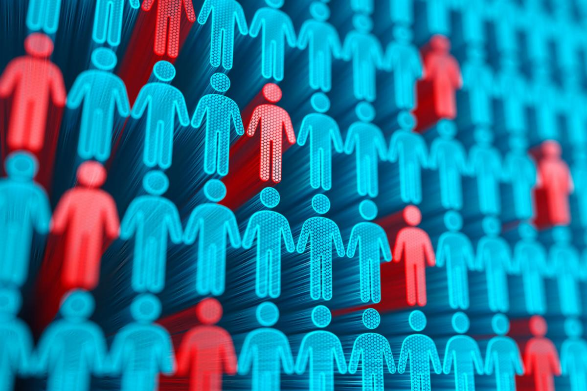 An illustration of rows of blue people icons with various red people icons scattered throughout