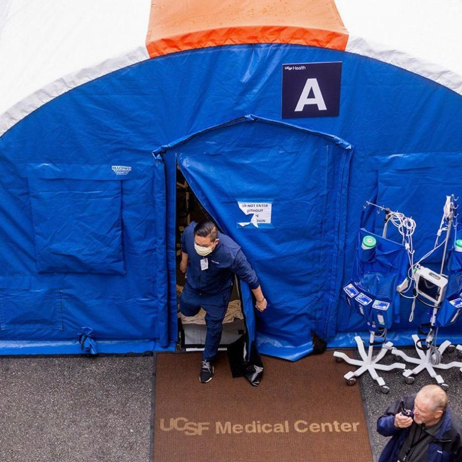 Man exiting ACU tent on Parnassus