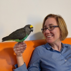 Michelle Underhill with adopted Meyers parrot Virgil