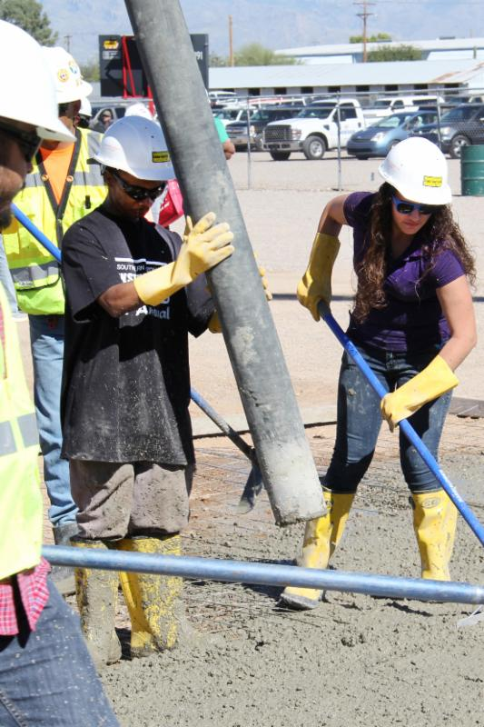 Students working with cement