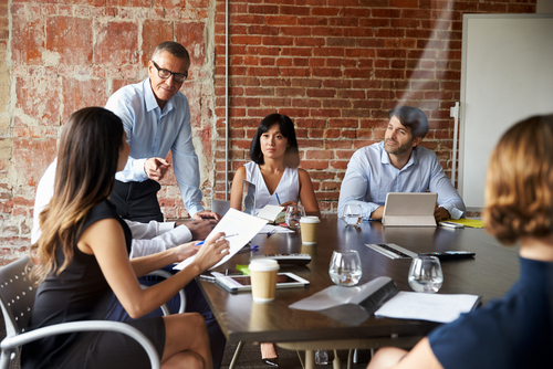 Businesspeople Meeting In Modern Boardroom Through Glass