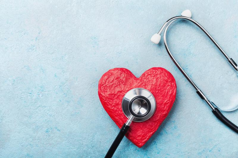 Medical stethoscope and red heart on blue background top view. Healthcare_ pulse_ heartbeat_ medicare and cardiology concept.