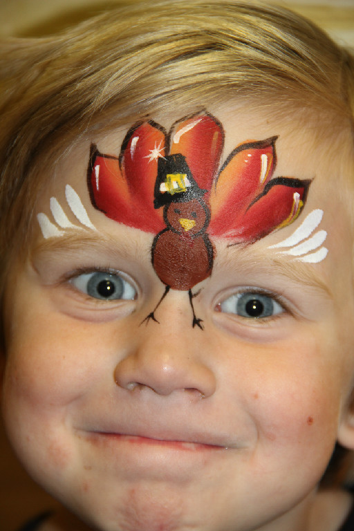 Boy with Turkey Painted on Face