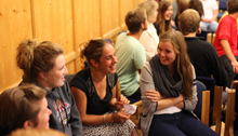 Photo of young adults happily chatting