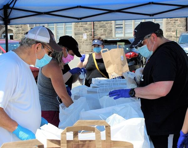 Family Promise of Bergen County volunteers distribute meals provided by World Central Kitchen