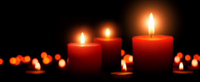 Three mourning candles by Shutterstock