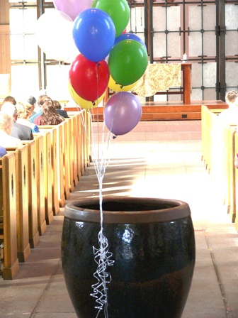 Balloons on Baptismal Font