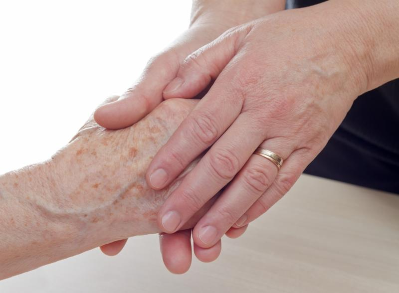 Young hand holding an elderly woman s hand