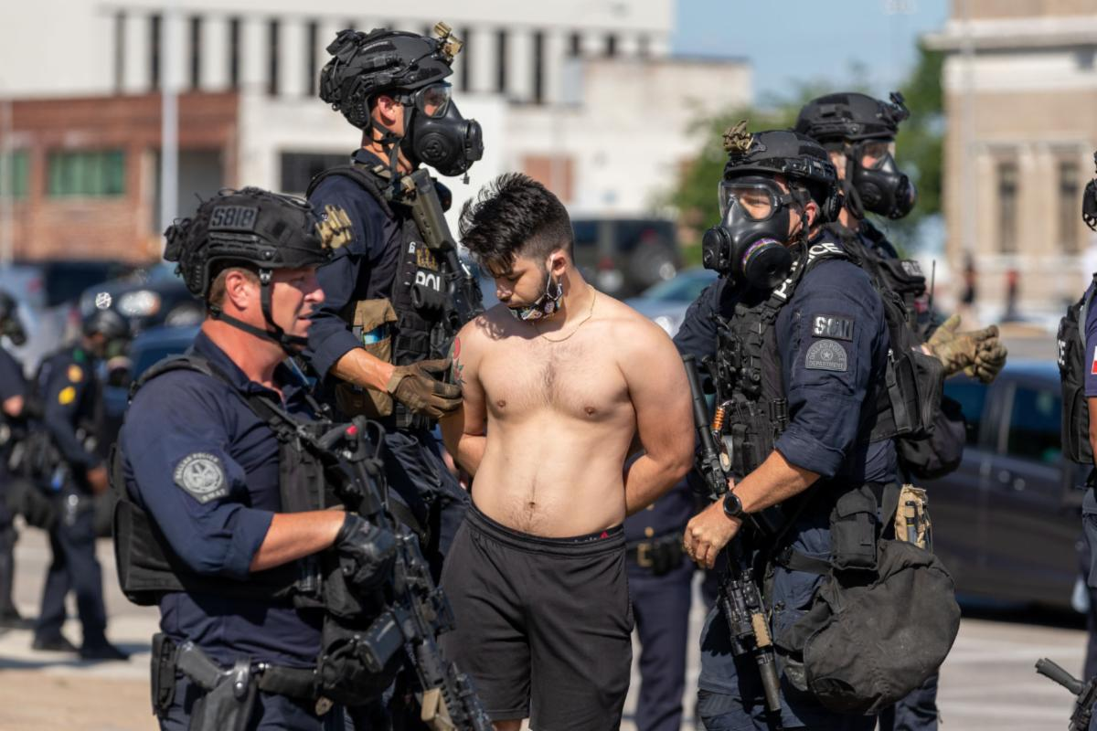Dallas Police arrest a protester during a demonstration against police brutality May 30 in Dallas. Several protesters were arrested during the event.