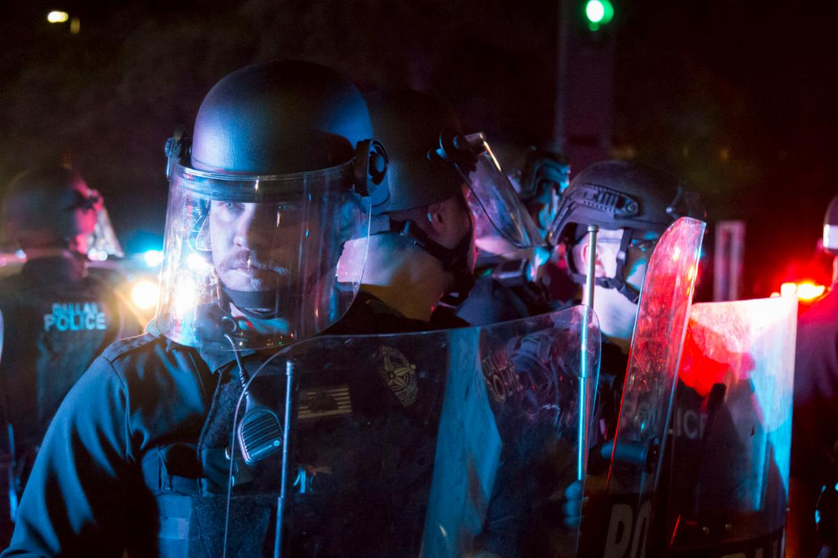 Dallas police officers with riot control gear stand during a protest against police brutality May 29 in Dallas. Gov. Greg Abbott activated the Texas National Guard Saturday in response to protests across the state.