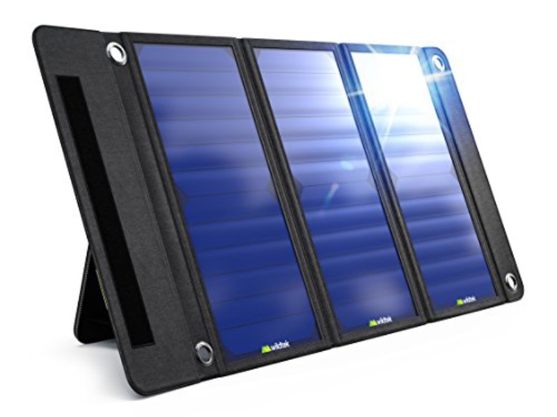 3-paneled portable folding Wildtek 21W solar charger is fully extended and tilted at a slight angle on its attached stand