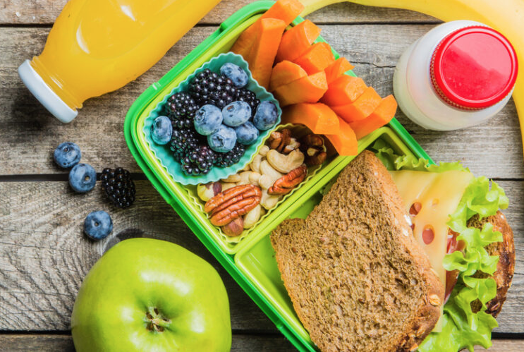 School lunch filled with fresh fruit and veggies