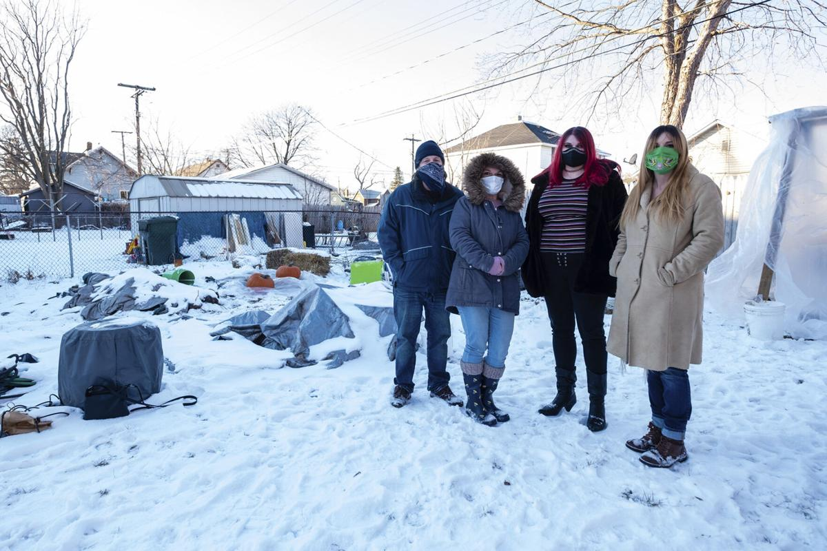 Group of Port Huron Urban Farming Initiative organizers stand at the farm property