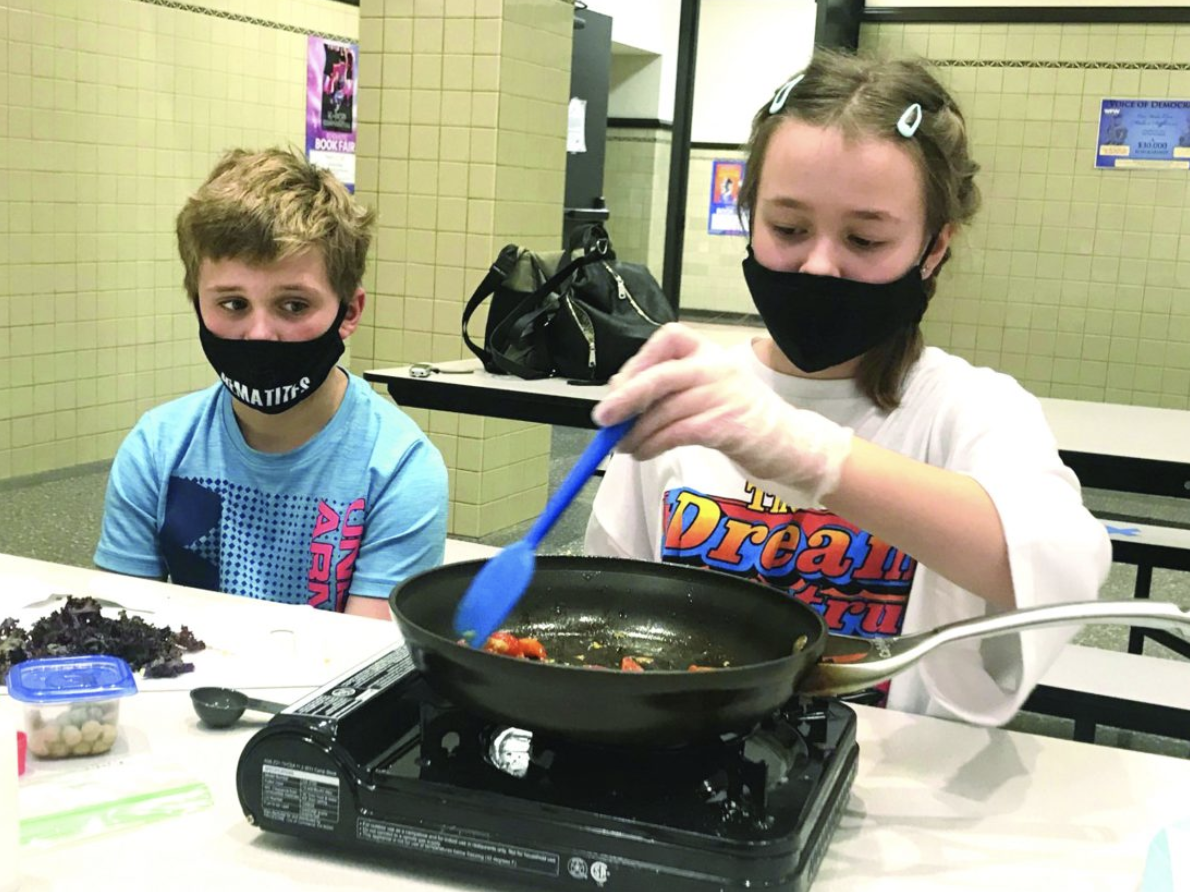 Fifth graders at Ishpeming Middle School cook kale and chickpea pasta
