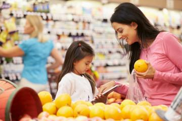 Mom and daughter grocery shop together