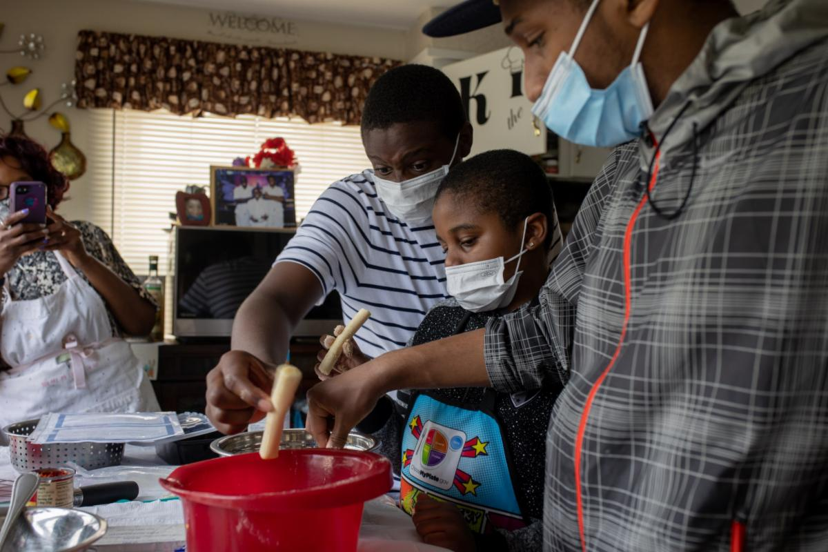 Two brothers follow the Flint Kids Cook virtual class to make breadsticks.