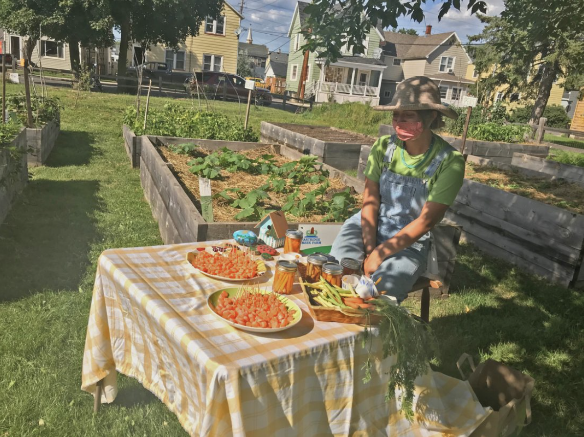 Emily Bateman is a senior at Northern Michigan University and an intern with Partridge Creek Farm in Ishpeming. She works at the school garden by Ishpeming Middle and High School. Photo by Christie Mastric.