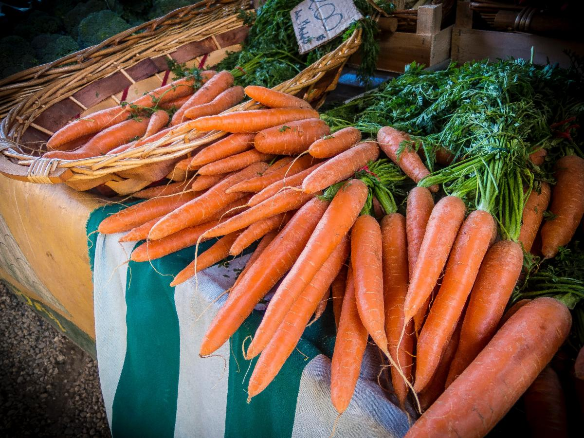 Orange carrots at a market stand