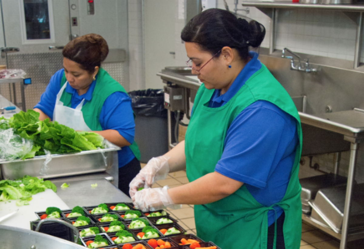 School food service prepares fresh veggie trays for kids
