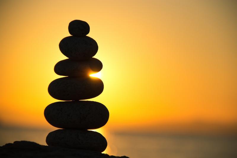 balanced stones and sunrise image