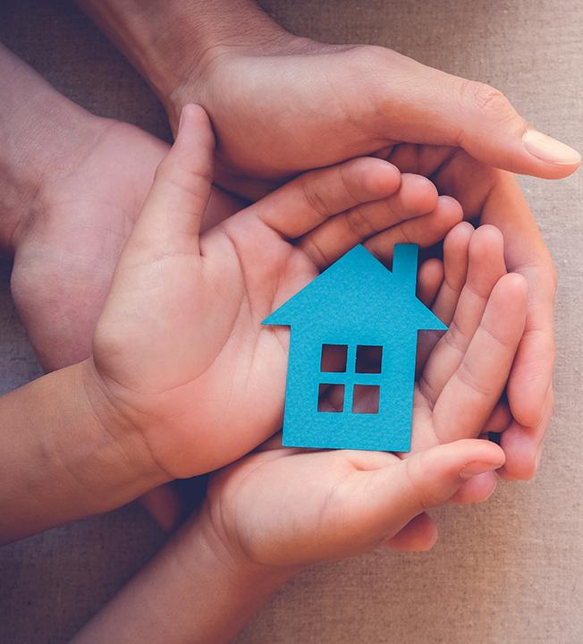 Hands holding paper house image
