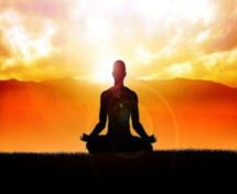 silhouette of meditation at orange sunset