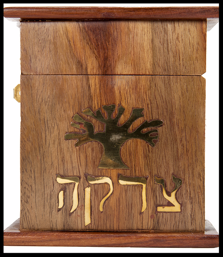 A Tzedakah box against a white background