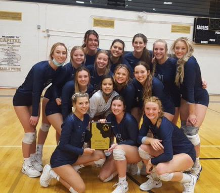 The Skyview volleyball team poses with their trophy.