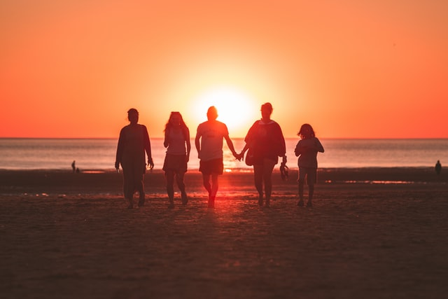 family group silhouette at sunrise