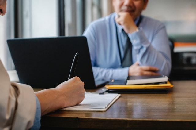 two people talking across desk