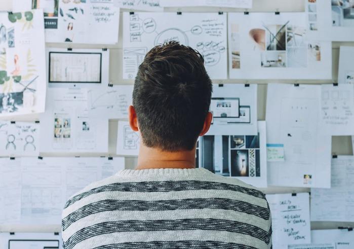 Man viewing charts on wall