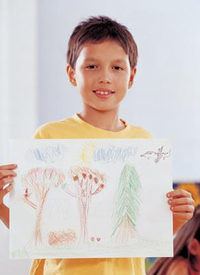 boy-holding-drawing.jpg