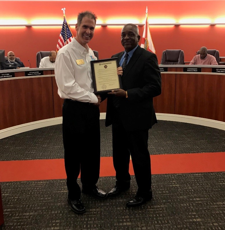 Photo of Mayor handing Proclamation for Public Works Week
