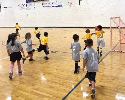 Photo of children playing indoor soccer at Lake Eva Gym