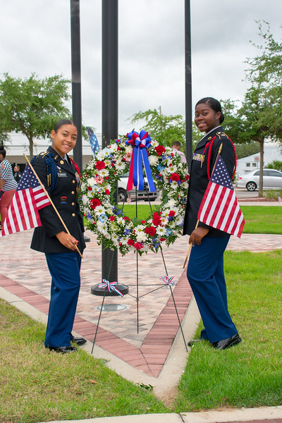Photo of young girls by flower wreath at 2018 Memorial Day Event