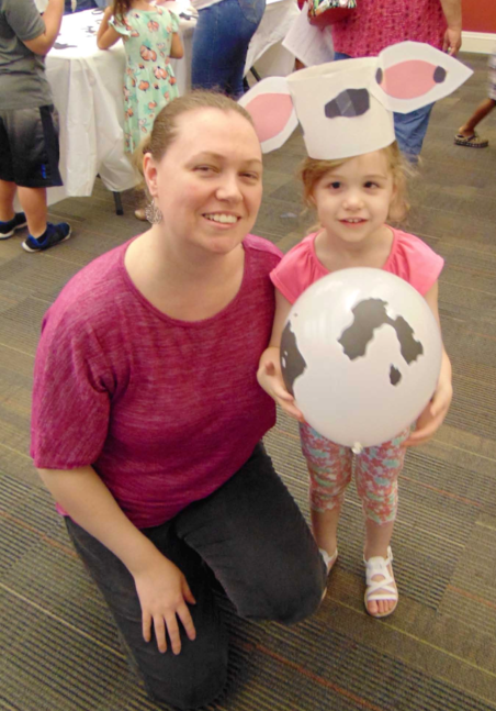 Photo of Adult and Child attending summer reading kick-off event