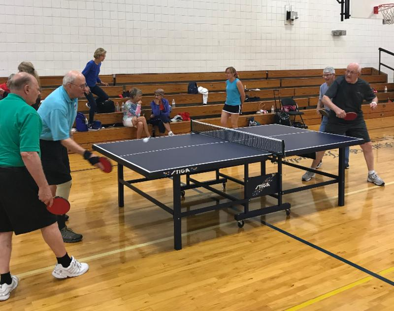 Photo of seniors playing ping pong