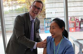 North York General Hospital President and CEO Dr. Tim Rutledge gives the flu shot to Hye Youn Kim, a Team Attendant in the Surgery Short Stay Unit, at the launch of the 2016 flu campaign on Oct. 18.
